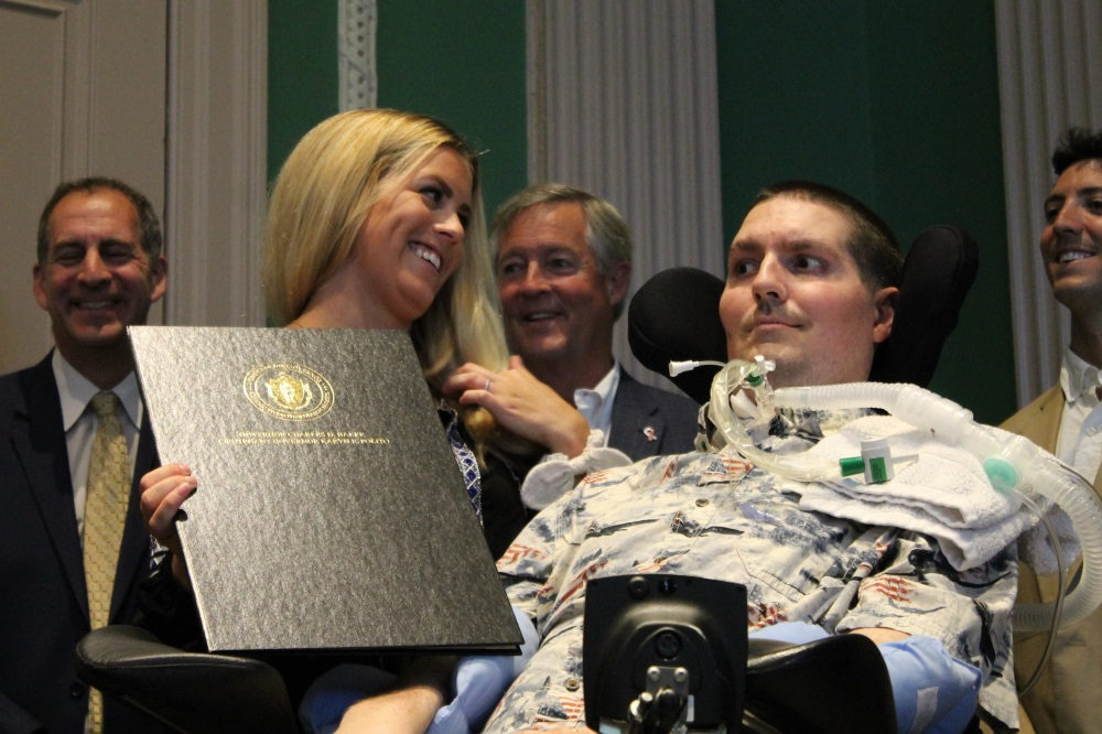 """Julie Frates held the newly-signed """"Ice Bucket Cha"""