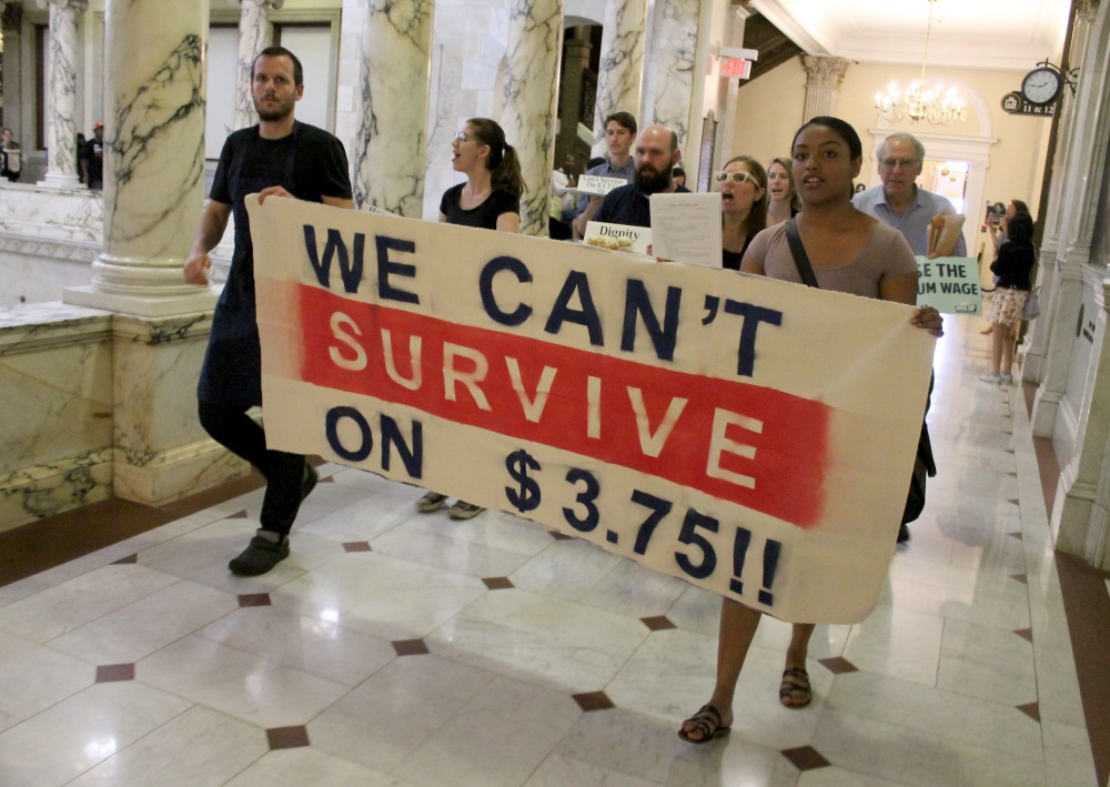 Activists marched inside the State House this week