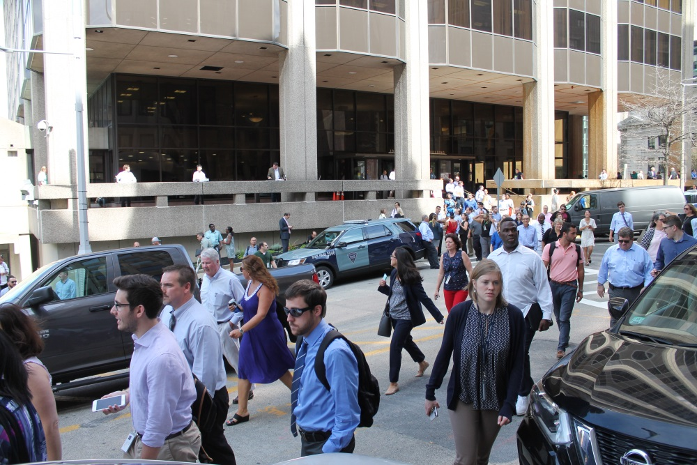 State employees streamed out of the McCormack offi