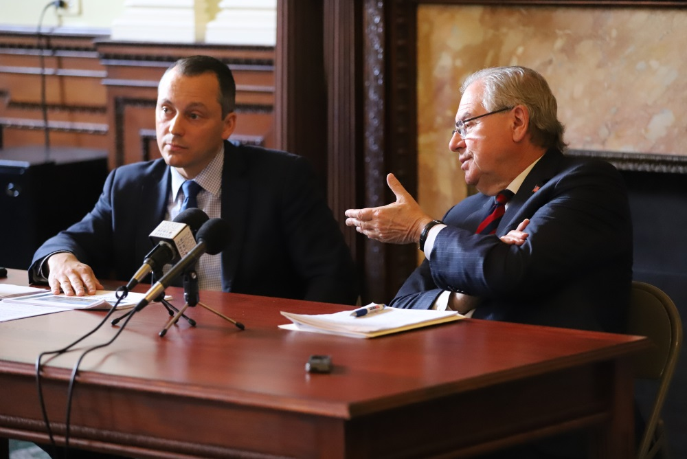 Speaker Robert DeLeo (right) said he is pushing the House's transportation funding debate into the new year, after consulting with his budget chief Rep. Aaron Michlewitz (left) and other key chairmen. [Photo: Sam Doran/SHNS/File 2019]