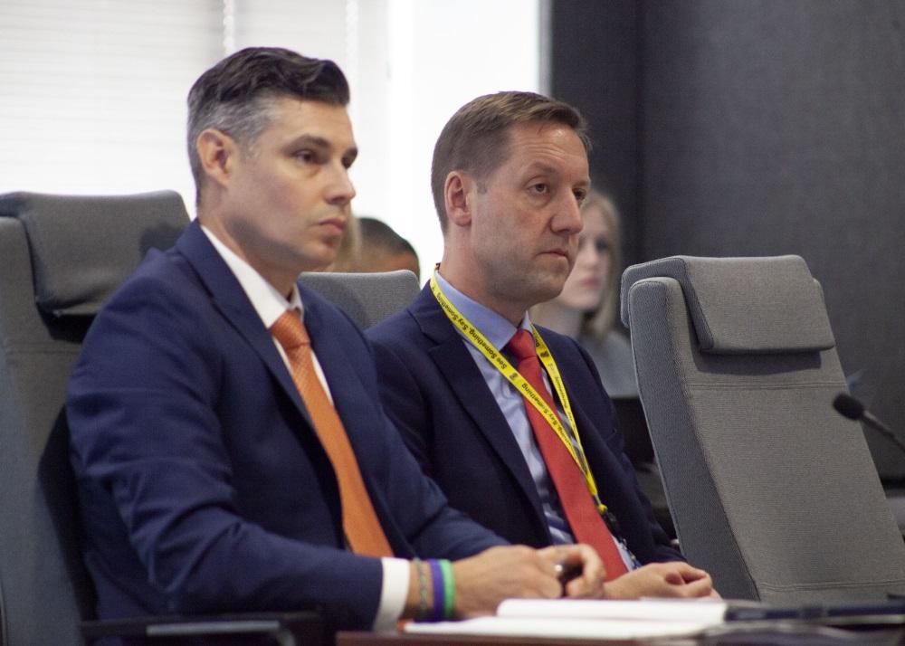 MBTA General Manager Steve Poftak (right), seated