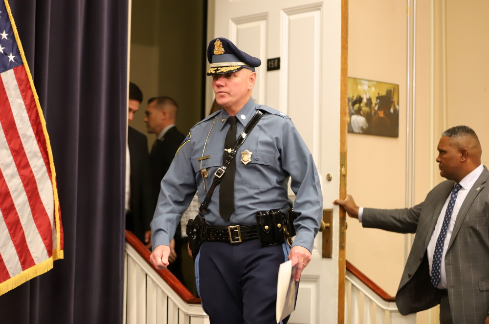 State Police Lt. Col. Christopher Mason, who on Friday takes the helm of the scandal-plagued agency as its colonel and superintendent, walked into a State House press conference Wednesday where he was introduced to reporters. [Photo: Sam Doran/SHNS]