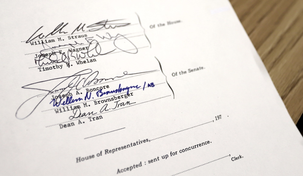 All six House and Senate negotiators signed off on the compromise distracted driving bill. [Photo: Sam Doran/SHNS]