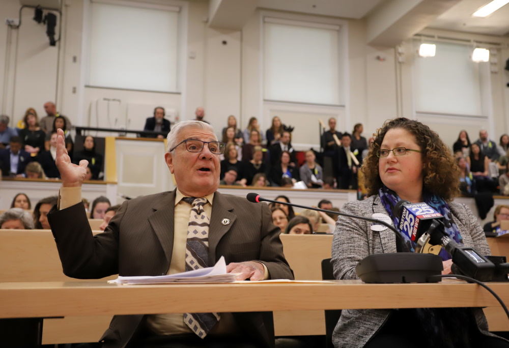 Rep. Paul Donato, testifying alongside Sen. Becca Rausch (right), gestured to the large crowd that filled Gardner Auditorium on Tuesday attracted by two vaccine-related bills. [Photo: Sam Doran/SHNS]