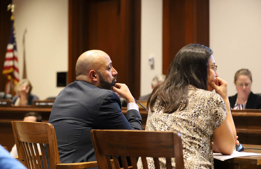 """Boston Health and Human Services Chief Marty Martinez (left) said proposed questioning of patients would """"identify red flags."""" [Photo: Sam Doran/SHNS]"""