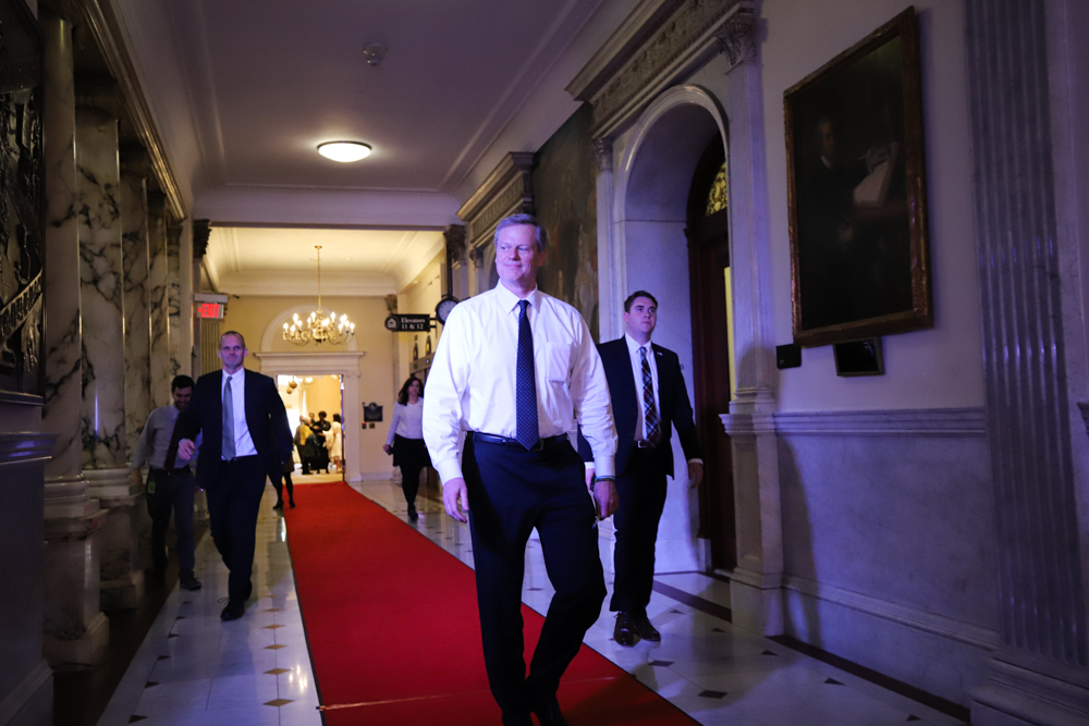 Gov. Charlie Baker walked the red carpet toward the House Chamber on Tuesday afternoon to rehearse for his State of the Commonwealth speech. [Photo: Chris Van Buskirk/SHNS]