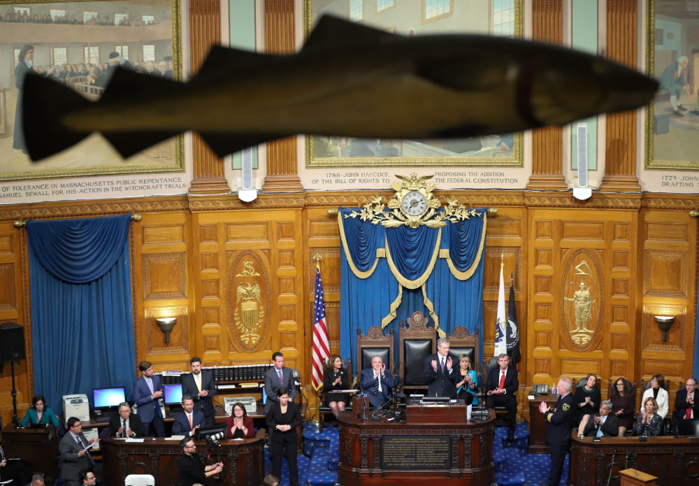 "The ""Sacred Cod,"" a historical carved symbol, swam high over the action on Tuesday night while Gov. Charlie Baker outlined his priorities for 2020. [Photo: Sam Doran/SHNS]"