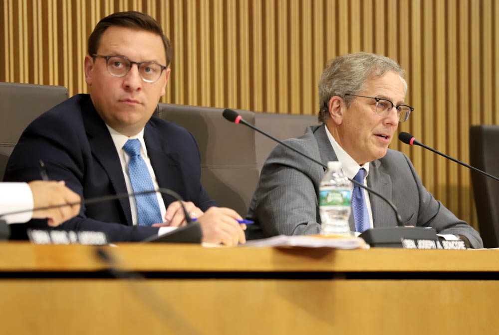 Rep. William Straus (right) said he's waiting to hear back from his transportation co-chairman, Sen. Joseph Boncore (left), about moving the governor's transportation bond bill out of committee. [Photo: Sam Doran/SHNS/File 2019]
