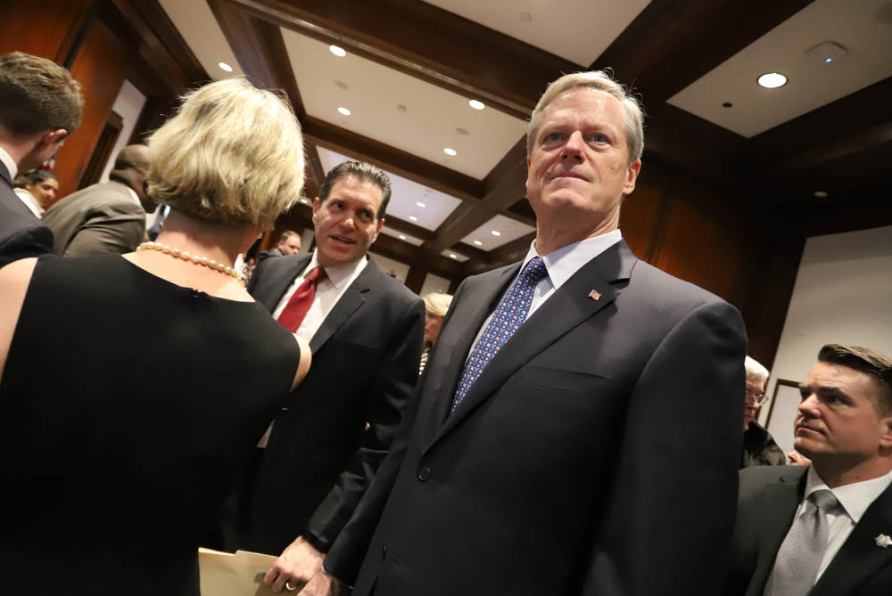 As Gov. Charlie Baker walked into a crowded hearing room Tuesday to advocate for his health care reform bill, he was approached by Sen. Barry Finegold (left) who later testified that he isn't satisfied with Baker's proposal. [Photo: Sam Doran/SHNS]