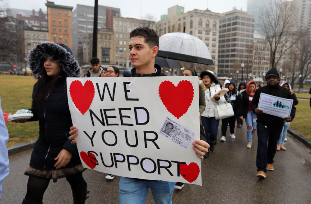 Bruno Moreira was among the marchers carting Valentine's Day cards, candy, and cupcakes up to the State House on Thursday from 32BJ SEIU's downtown headquarters to ask or thank lawmakers for support of a bill to make driver's licenses available to undocumented immigrants. [Photo: Sam Doran/SHNS]