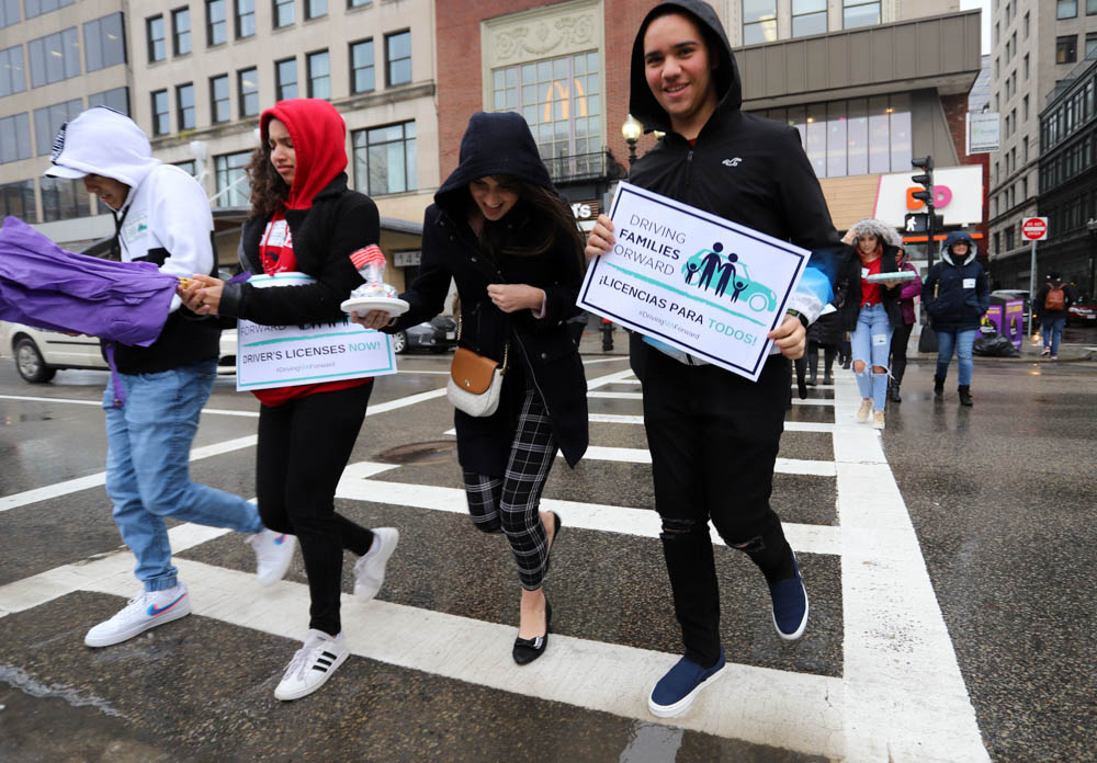 Activists hopped across Tremont Street on Thursday on a drizzly march to the State House bearing candy and Valentine's Day cards to lobby lawmakers on a bill to make driver's licenses available to undocumented immigrants. [Photo: Sam Doran/SHNS]