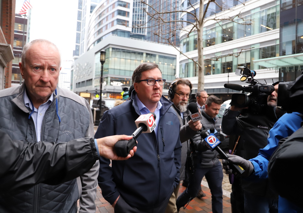 Rep. David Nangle had no comment Feb. 18, 2020 as he walked from the Moakley Federal Courthouse to an idling car after pleading not guilty to numerous campaign finance-related charges, including wire fraud and bank fraud. [Sam Doran/SHNS]