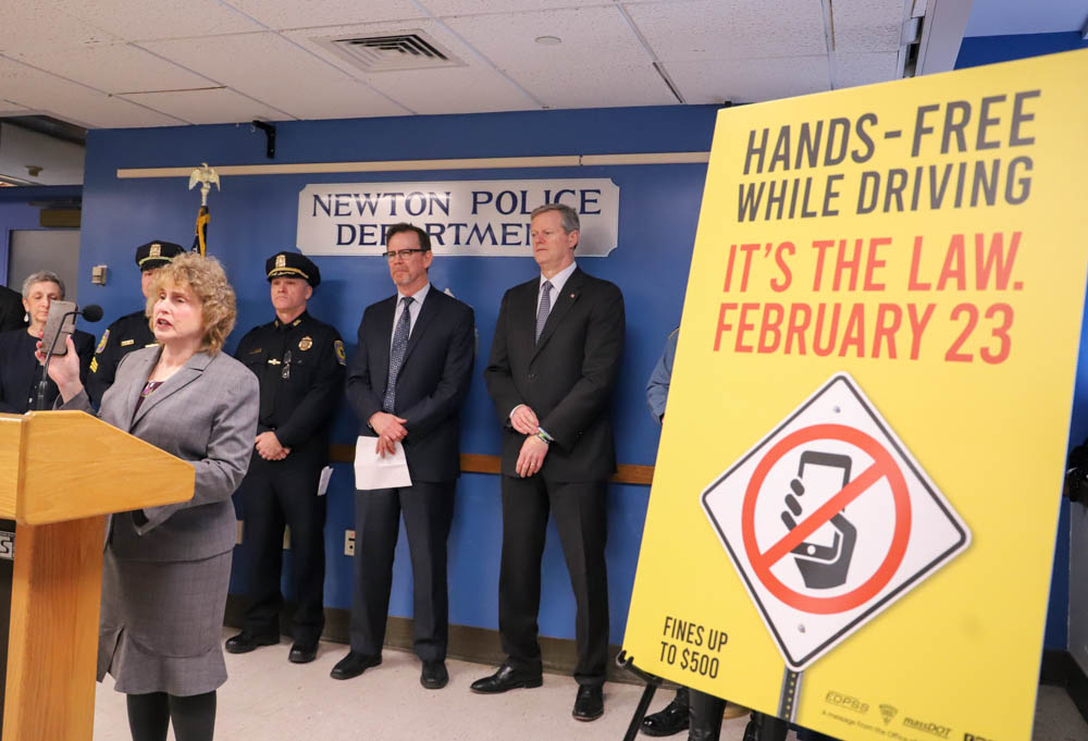 Transportation Secretary Stephanie Pollack held up her cell phone during a press conference Thursday about implementation of the new safe driving law. [Photo: Sam Doran/SHNS]