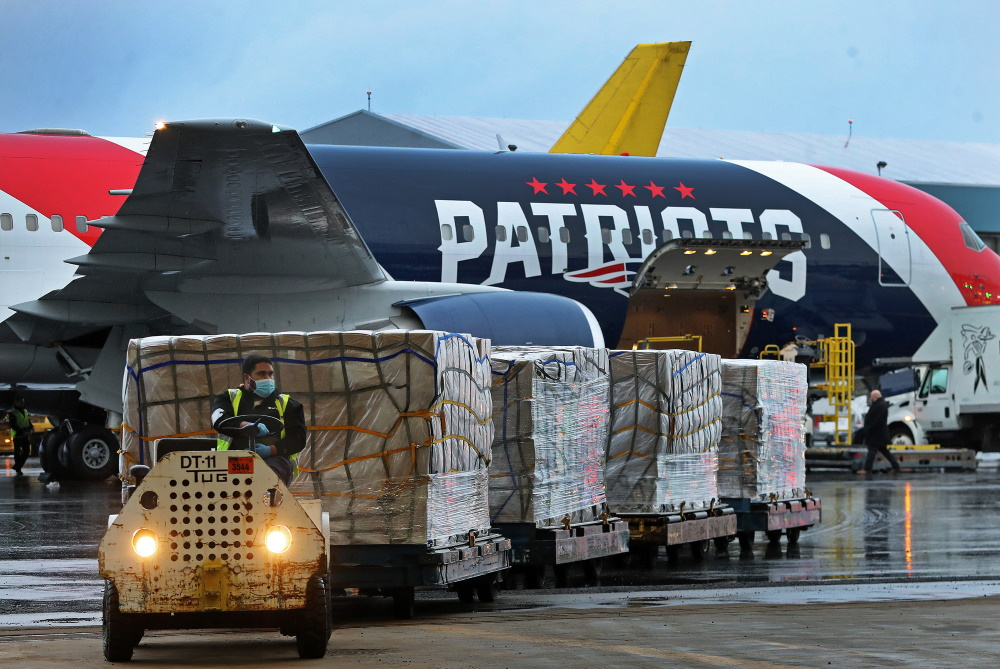 More than a million medical masks were unloaded from the Patriots' Boeing 767 at Logan Airport on Thursday, the fruits of a complex, back-channel humanitarian mission. [Photo: Jim Davis/Boston Globe/Pool]