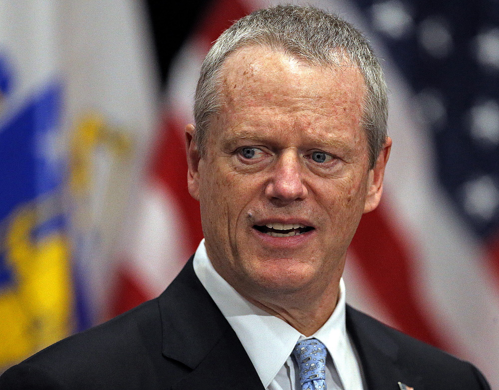 """We see evidence that we're still on the upward slope of this pandemic,"" Gov. Charlie Baker said at his COVID-19 briefing on Wednesday. [Photo: Matt Stone/Boston Herald/Pool]"