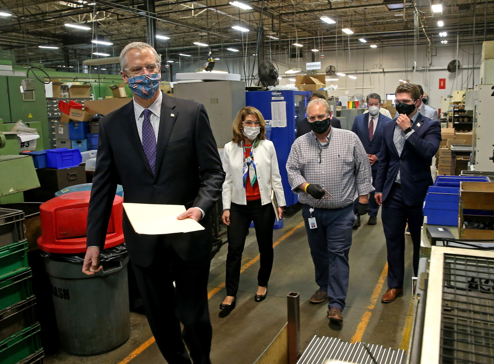 Gov. Charlie Baker and Lt. Gov. Karyn Polito toured Symmons Industries, a plumbing parts manufacturer in Braintree, on Wednesday to see firsthand how a local business is implementing new workplace safety standards. [Photo: Matt Stone/Boston Herald/Pool]