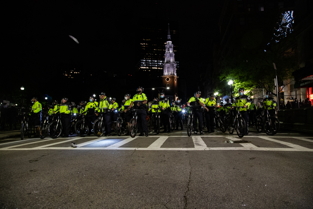 Boston police advanced south along Tremont Street toward Boylston Street on the night of May 31. [Chris Van Buskirk/SHNS]