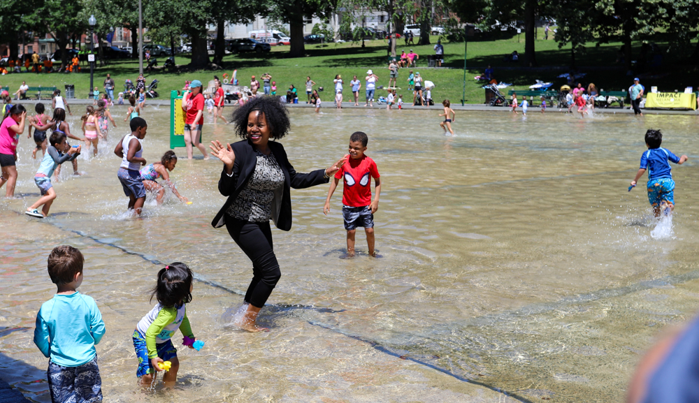 Acting Mayor Kim Janey waded into the Frog Pond on Thursday after officially opening the spray pool for the summer season. [Sam Doran/SHNS]