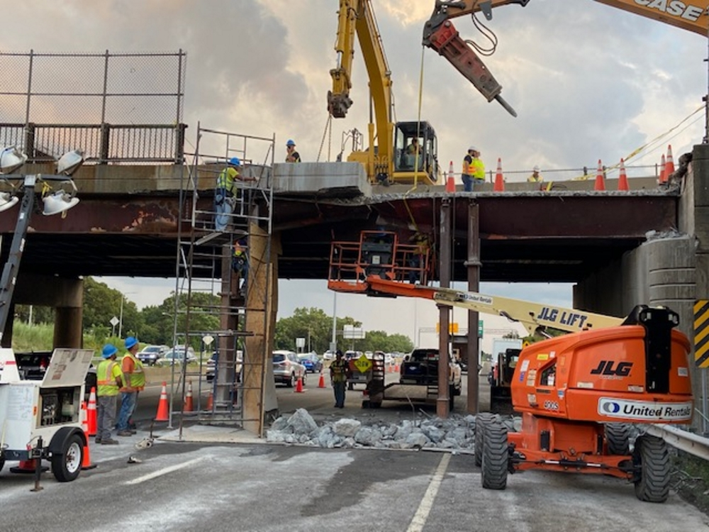 Crews work on Wednesday, July 21 to repair damage to the Roosevelt Circle overpass above Interstate 93 in Medford. [Courtesy: MassDOT]