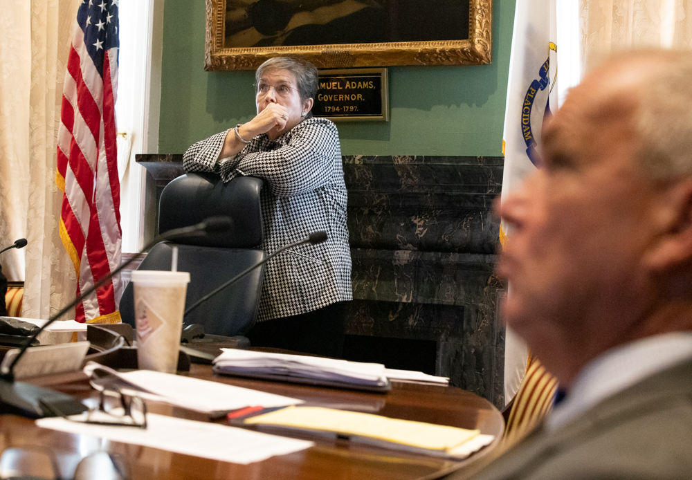 Councilor Mary Hurley looks up toward the clock Wednesday during a Governor's Council hearing she was presiding over which was not livestreamed, breaking with the panel's practice. [Sam Doran/SHNS]