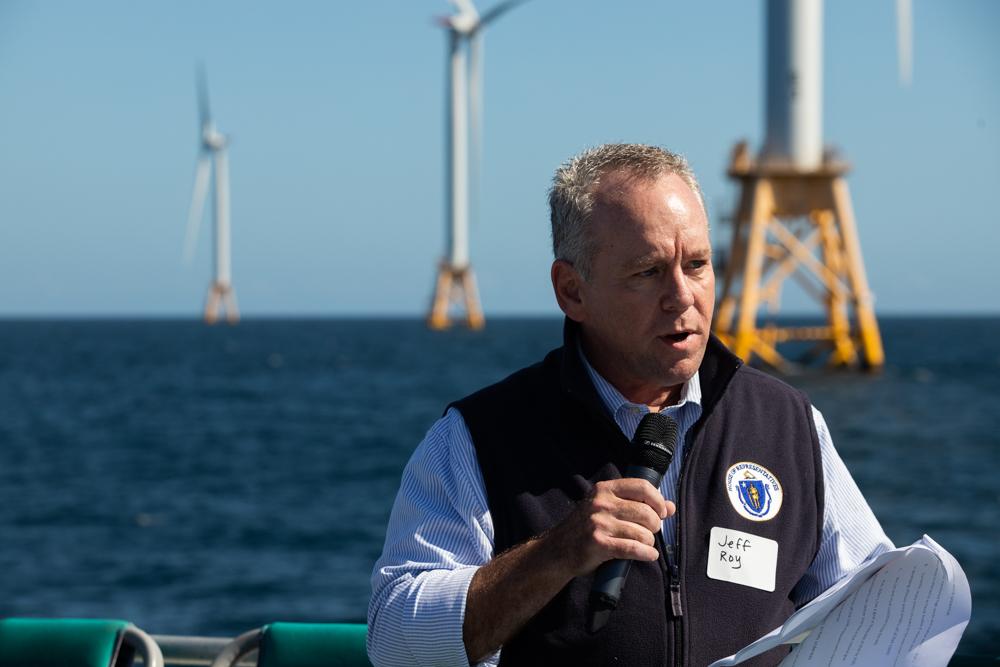 Telecommunications, Utilities, and Energy Committee House Chair Jeff Roy speaks during a legislative boat trip to the Block Island Wind Farm off Rhode Island. [Chris Van Buskirk/SHNS]