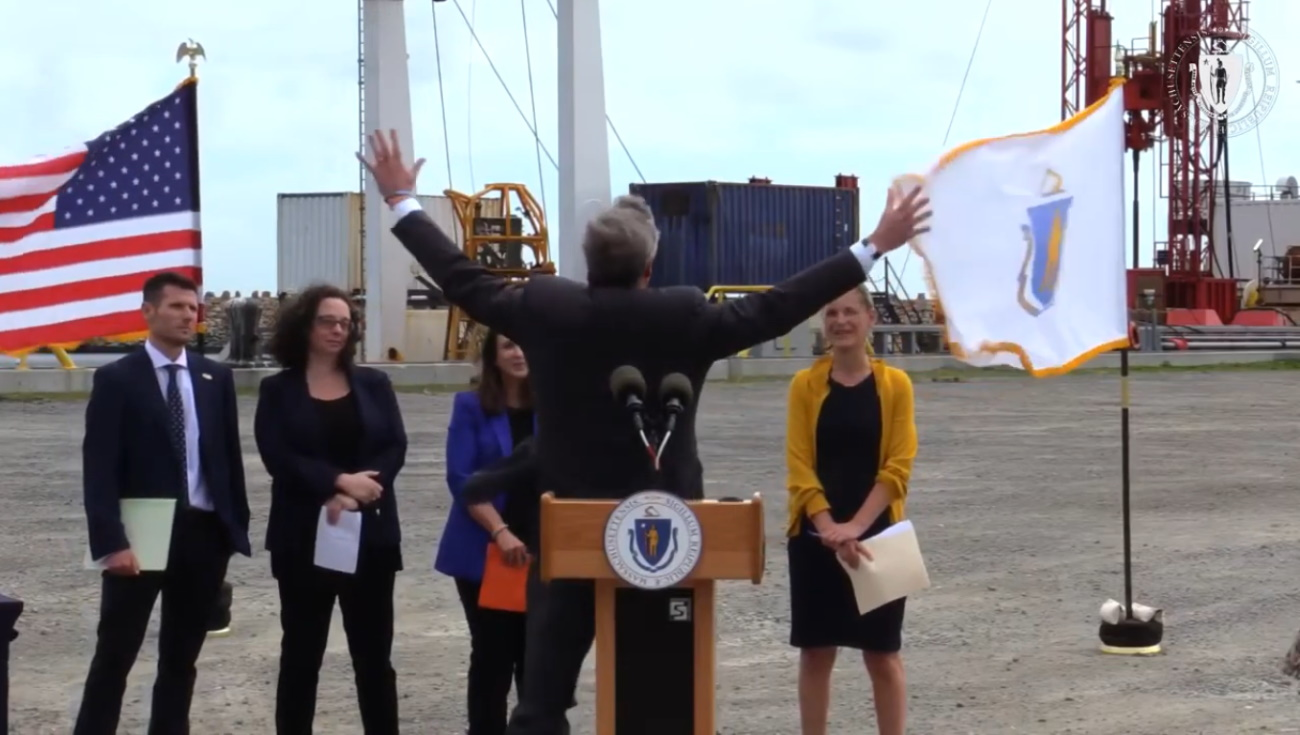 """""""What do you think, is this a pretty good place for wind, yes or no?"""" Gov. Charlie Baker said as he pretended to be blown away by the breeze during a Wednesday visit to an offshore wind workforce training site at the New Bedford Marine Commerce Terminal. [Screenshot]"""