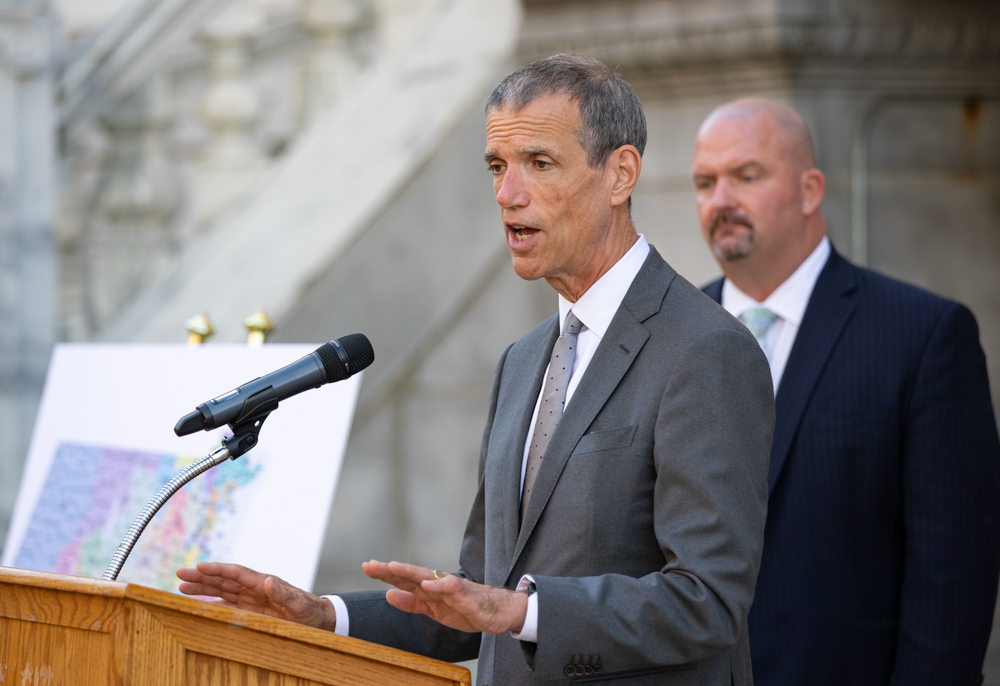 """Redistricting Committee Co-chair Sen. Will Brownsberger, pictured at a Tuesday press conference where he released the Senate's proposed map changes, faced criticism at a hearing Friday about the map not combining Brockton and Randolph into a single district.  """"If there was a Voting Rights claim there, believe me, we would do it,"""" he said. [Sam Doran/SHNS]"""